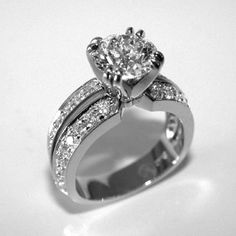 Round diamond ring from Oliver Smith Jeweler.