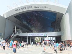 Entrance.   The image of a huge LED panel is meeting.