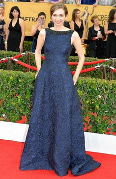 Lauren Lapkus in a navy jacquard Badgley Mischka Resort gown with an embellished neckline.