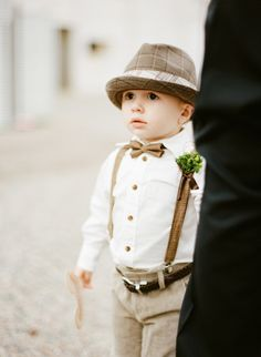 this look is way too adorable. what a precious little ringbearer! I would love this sort of theme for all the bridal party outfits for my wedding.