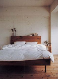 wood headboard. white comforter