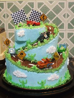 """This gives me ideas. Despite the perfect look of fondant, I love that there isn't fondant on this - it'll taste much better. Change: the topper: add a number """"3"""" & little pennant banner of racing flags, & one or two cars. It should have some brown """"land forms"""" to look like radiator springs or wheel well. Right now it looks like the road is floating in the sky. I'd like to add a bottom tier of black and white checkers with the Cars logo with B's name in Magneto Bold font (fondant for that logo.)"""