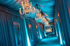 Fabric draping to create the perfect hallway to this Tiffany inspired party. |Photo: @dinadouglass. Coordination & Design: @soniasharmaevents. Design Decor & Rentals: @revelryeventdesign. Florals: @theemptyvase. Lighting: @cosmossoundhollywood.