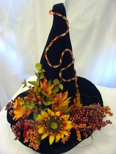 Autumn flowers and leaves witch hat.