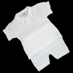 A 100% cotton knit set for baby boys that includes a cable knit sweater-shirt, knit pants. Hand wash....