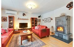 Tulikivi in a traditional living room, bringing heat to a three-storey home in Finland.