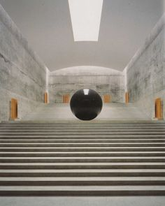 Lengthy stairs w cool large black ball in the center. Location: Chichi Art Museum, Naoshima, Japan