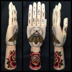 Large wooden hand mannequin with original drawings of a deaths head moth and rose with skull 'tattoo style'