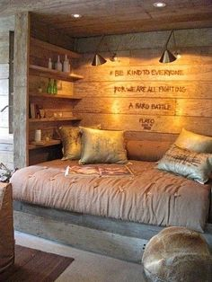 A built-in reading nook made from reclaimed wood. ... ALMOST MY A+ DREAM ROOM... ADD A FIREPLACE AND JDH :)