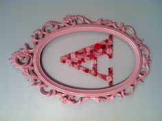 Combined the button initial and spray painted old mirror frame.