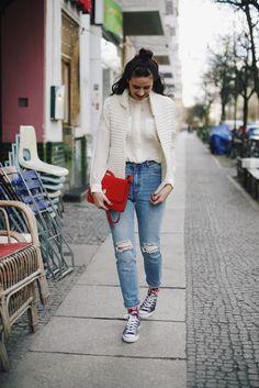 This is Jane Wayne. knit vest, high waist denim and chucks.