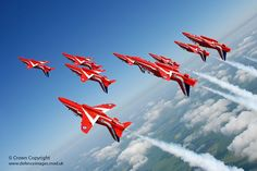 "The Royal Air Force Aerobatic Team (RAFAT), ""The Red Arrows"" display over RAF Scampton, Lincoln."