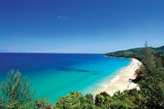 Stretch of pristine sand and clear water at the south end of Naithon Beach.