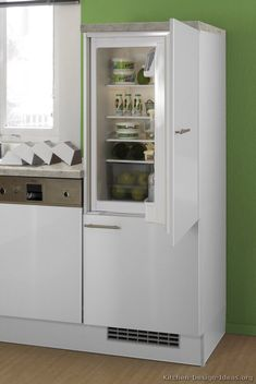 Modern White Kitchen Cabinets with built-in white Euro-style refrigerator (custom cabinet panel allows refrigerator to match cabinets).