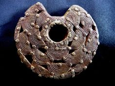 Dogon bronze coiled wire bronze pendant, 18th-19th century A.D. Private collection