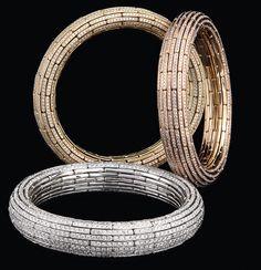 Nirav Modi - Elastic gold bangles. Thick bangles in yellow, white and pink gold.