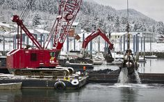 Juneau: Douglas Boat Harbor dredging project deepens the harbor to a depth of 14'.