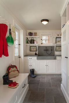 Keep the mud from the room- you can wash off before you come in the house! Pretty floor eccoes the marble countertops. And there are so many cabinets to put in your shoes and other stuff. I'm in love with the cute shelves and hooks.