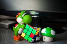Yoshi playing with rubix cube