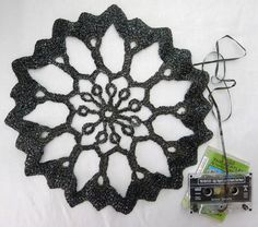 Artist Jennifer Cantwell crochets with cassette tapes. This would be fun to try and DIY.