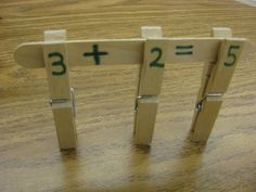Kids develop math concepts and fine motor skills as they build math facts using clothespins and craft sticks