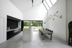 love the wall mounted swing arm lamps as dining room lighting:  House in Dendermonde, Belgium - Pascal Francois Architects