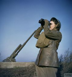 A member of the ATS (Auxiliary Territorial Service) serving with a 3.7-inch anti-aircraft gun battery, December 1942.