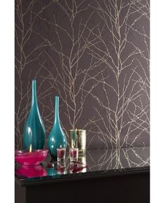 Graham & Brown - Vitality Wallpaper. Featuring gloss and metallic overlays, this stunning silhouette sprig design creates a modern twist on a semi-plain. >>> This is going up in a clients in the next 2 weeks!