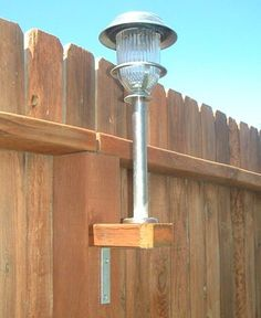 "Great idea for a back yard: Use solar lights on the fence. Take a and cut them into squares to fit the existing fence posts. Using galvanized screws - not nails - to screw a ""L"" bracket to the underneath base. Then on top, screw on the stake. Diy Garden, Lawn And Garden, Home And Garden, Outdoor Projects, Home Projects, Outdoor Lighting, Outdoor Decor, Backyard Lighting, Fence Lighting"