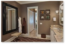 Add drama with color: The contrast of  chocolate brown walls  with white wood work  adds drama.