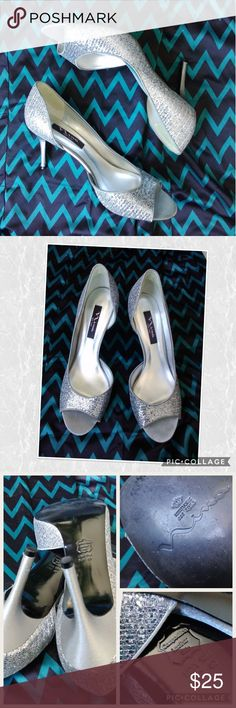 ✴️JUST IN!✴️ Sexy Silver Peep Toe Heels D'Orsay styled satin stilletos (say that fast 3 times!) are perfect for that special occasion where dealing is on the menu. Gorgeous with a dress or slacks, these will add length to your legs visually. Composition leather sole, fabric upper. Smoke and pet-free home. Nina Shoes Heels