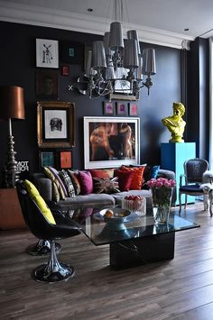 pop art and art deco london apartment with grey sofa and colorful cushions also spinable black chairs and glass coffee table also bushed nickel pendant light shades and wall art interior design ideas