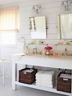 Plank walls, open vanity with baskets. little glass shelves above vanity for toiletries