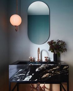 Modern art deco style mirror in bathroom with black marble vanity and sink. Ultra modern and chic Bathroom Trends, Bathroom Interior, Modern Bathroom, Marble Bathrooms, Bathroom Ideas, Luxury Bathrooms, Bathroom Mirrors, Bathroom Designs, Bathroom Black