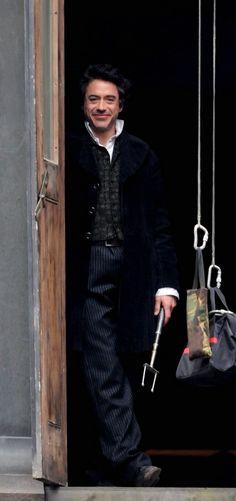 """RDJ preparing to leap from a window in """"Sherlock Holmes."""""""