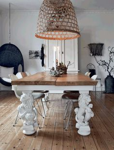 The over-sized table and basket light fixture make this dining room stand out.