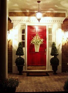 beautifully lit entry way, gorgeous red door.
