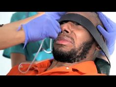 Yasiin Bey (aka Mos Def)  demonstrates being force fed under standard Guantánamo Bay procedure. WARNING: Disturbing footage, some sensitive viewers may not want to view.
