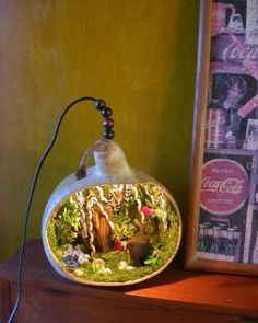 DIY: .. Fairy garden / home. Good idea for night light. Looks great. I don't know if I could pull it off though.