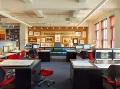 In the spacious studio area, red accents appear in the form of ergonomic desk chairs and stools by Humanscale and ribbon trim on bespoke walnut blinds. The architects work both in lead pencil and on computers with visualization software.