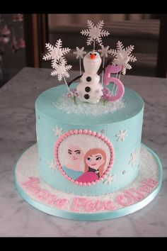 Frozen buttercream birthday cake with all fondant accents!