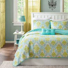 The Mizone Paige quilt set is the perfect way to add color and style to your bedroom. This quilt set brings in a great combination of turquoise blue with an apple green color to create a fun damask pattern.