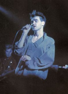 Morrissey and Andy Rourke (in the backgorund) on stage with The Smiths at Royal Albert Hall, London, England on April 06, 1985 -- photo by Stephen Wright.