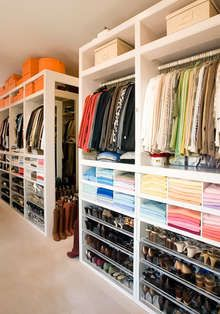 """What about this for our Master Closet? Large amount of floor space on both sides of the """"bookcase"""" pieces so Brent and I aren't running over/bu,ping into each other while we are getting ready? Also shelving/hanging areas/ shoe & bag storage/ mirrors on the other walls of both sides."""