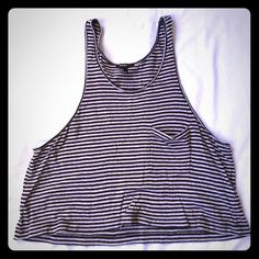 Forever 21 muscle tank Brand new without tags forever 21 black and gray striped muscle tank. It has a low sleeve so your sport bra shows. The perfect tank for working out in. I'm typically a size small or extra small in forever 21. This tank is a size large, but could work for any size depending on how loose you want it. Forever 21 Tops Muscle Tees