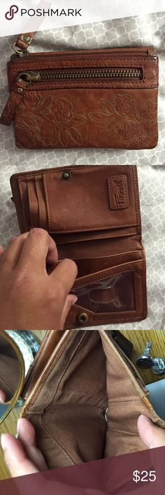 """Fossil wallet Fossil wallet in brown leather. Highway U skirt very durable. Preloved for sure and has a lot of wear but still looks nice and has a ton of life left. No rips or major stains. SOO many pockets and compartments it's unbelievable. 3.25 x 5"""". So great and very useful. See photos. Notice wear. YES I bundleNO TRADES EVER no low balls. Don't ask to trade I will say no even if I love your closet. Negotiable ONLY USE OFFER BUTTON Fossil Bags Wallets"""