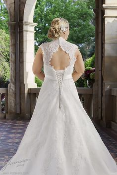 Glamour Plus wedding dress style: Beatrix Slim shaped lace dress with keyhole back neck and lace cap sleeves and empire feature.