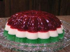 Christmas Jello Mold  1 (3 oz.) package raspberry jello  1 (16 oz.) bag frozen raspberries (This is my addition as I am not a fan of plain ...
