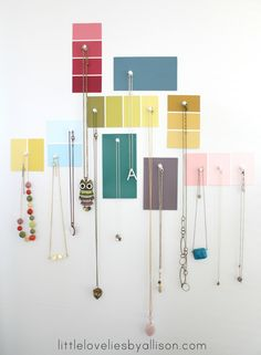 simple jewelry display using paint swatches and push pins. super quick, super cheap, easy to change with the seasons or if you're a renter. (organization, decorating)