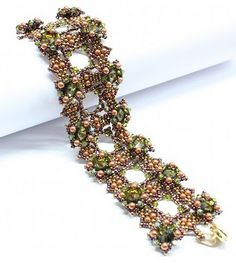 Try-to-be-better: Bracelet.  Her website has many kits and patterns to purchase.  Pretty work.